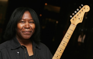 LONDON - FEBRUARY 01: Joan Armatrading poses with a guitar at the Born To Rock Exhibition at Harrods on February 1, 2007 in London, England. Guitars worth tens of millions of pounds were delivered by armoured security to the store and make up part of the Born To Rock Exhibition. (Photo by Gareth Cattermole/Getty Images)